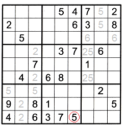 Sudoku puzzle partially filled with new number and ghost numbers that were found because of the T patterns